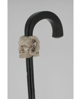 Ivory janus crooked handle with a satyre on one side and a skull on the opposite side, Ebony