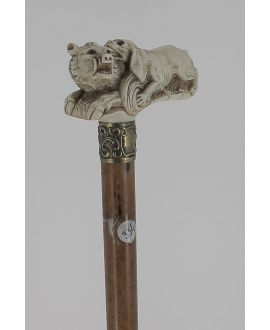 Ivory handle representing dog biting a boar. Malacca shaft