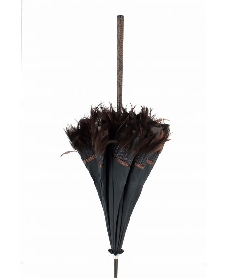 Sun umbrella with feather. Macassar wood shaft. Handle covered with python